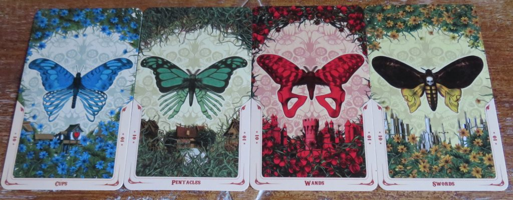 Transformation in the Santa Muerte Tarot Tens: the last card of the Minor cycle shows a fully formed butterfly. Review The Queen's Sword
