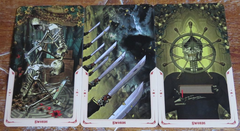 Santa Muerte Tarot Minors: a few examples of the Swords The Queen's Sword Review